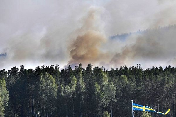 International assistance arrives in Sweden  to help fight '70 forest fires, large and small'