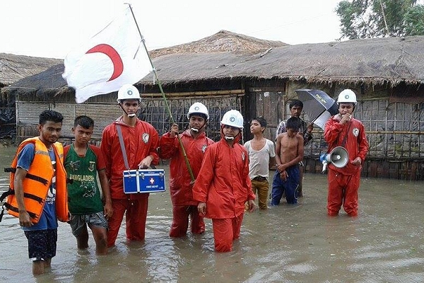 Over 55,000 community volunteers help move half a million people out of harm's way before Cyclone Roanu strikes Bangladesh