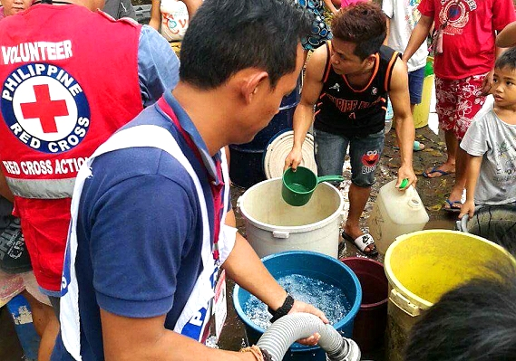 Philippine Red Cross personnel spend Christmas with families displaced by Vinta and Urduja